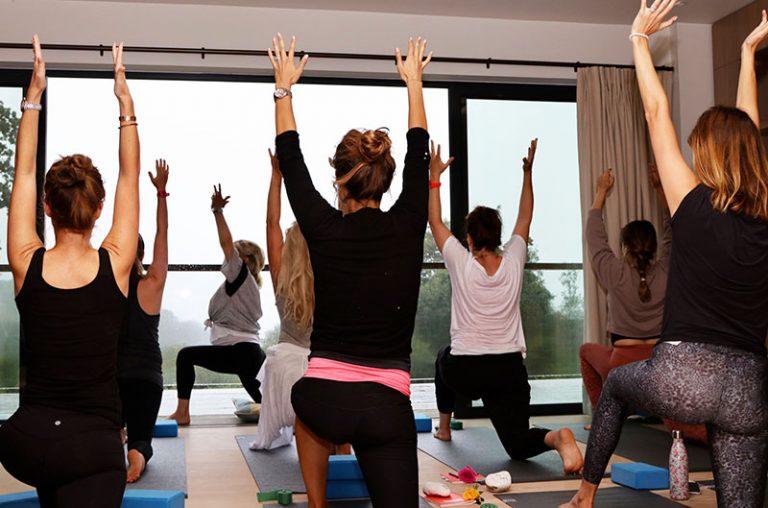 joanna hunt teaching yoga to group of ladies