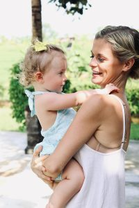 joanna hunt holding daughter and smiling 2