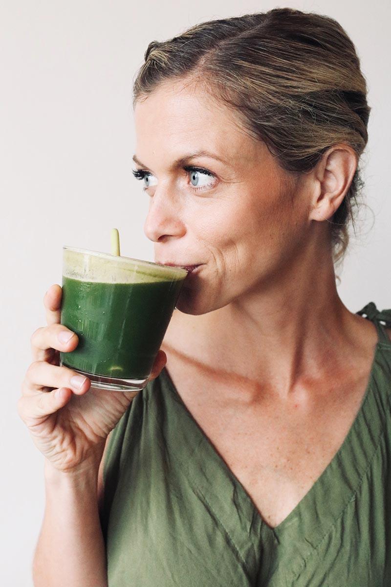 joanna hunt drinking green juice in a green dress