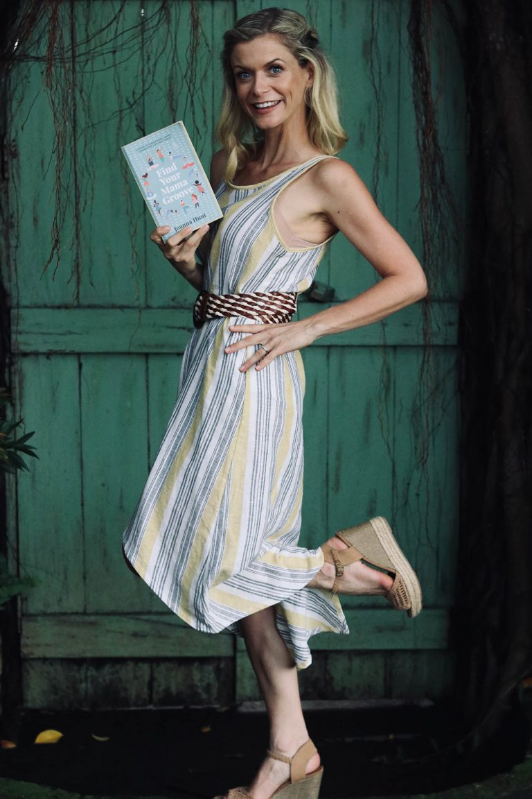joanna hunt standing with leg up and holding find your mama groove book