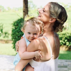 joanna hunt holding daughter and smiling square image